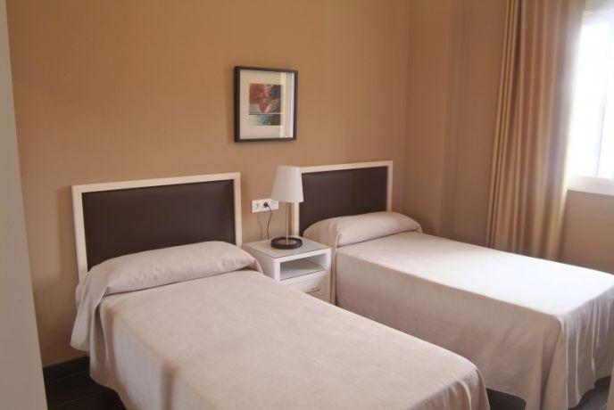 Junior Suite. Habitación cama twin con 2 dormitorios.